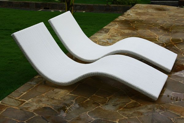 curved wicker sun lounger