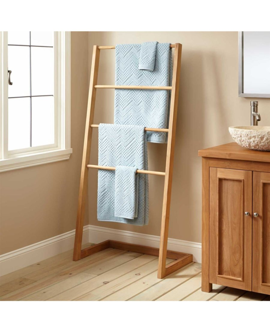 Teak is probably the best all-around material for towel hangers